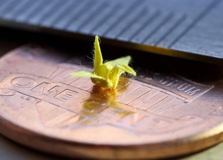 3 mm origami crane. creddit.. inb4 this 3 mm origami crane creddit inb4 this