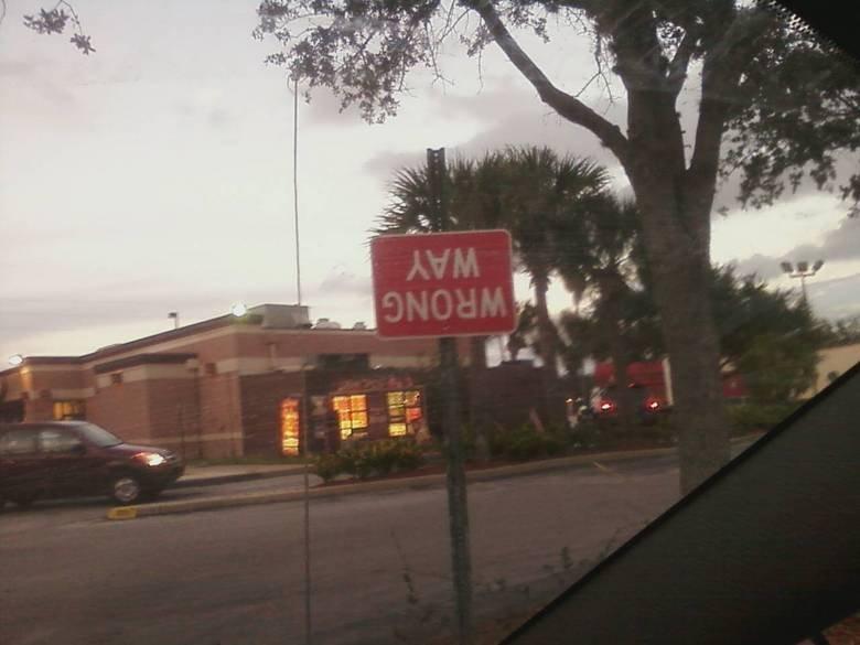 sign. . sign wrong way upside down