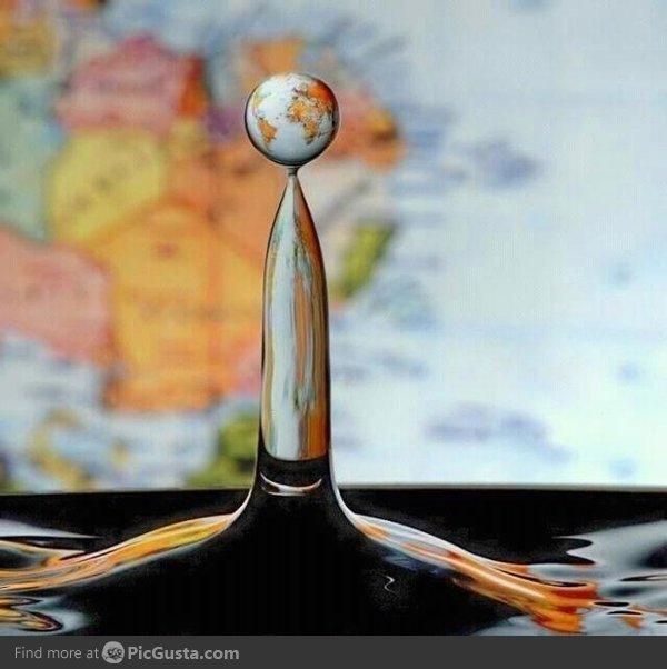 Water Drop. Behind a world map.. Water Drop Behind a world map